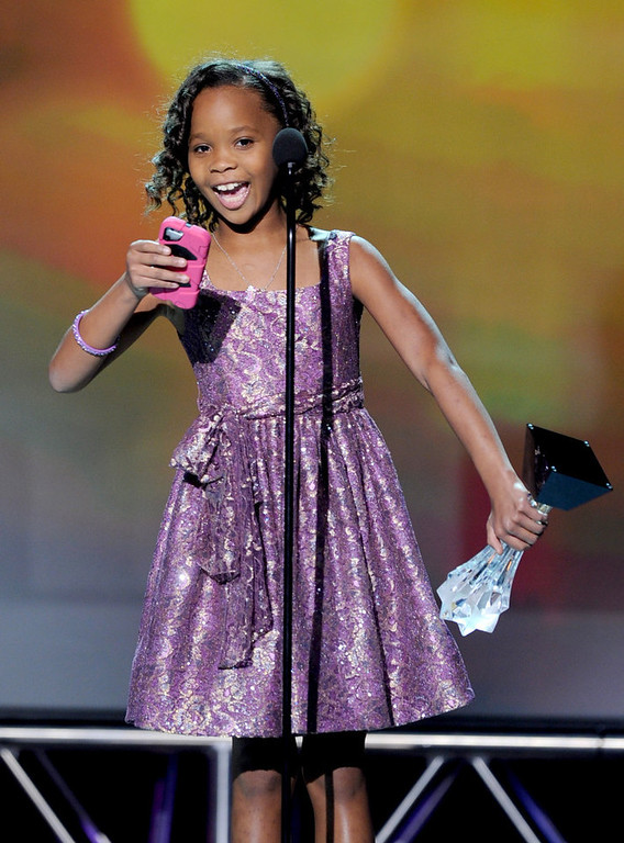 ". Actress Quvenzhane Wallis accepts the Best Young Actress Award for ""Beasts of the Southern Wild\"" onstage at the 18th Annual Critics\' Choice Movie Awards held at Barker Hangar on January 10, 2013 in Santa Monica, California.  (Photo by Kevin Winter/Getty Images)"