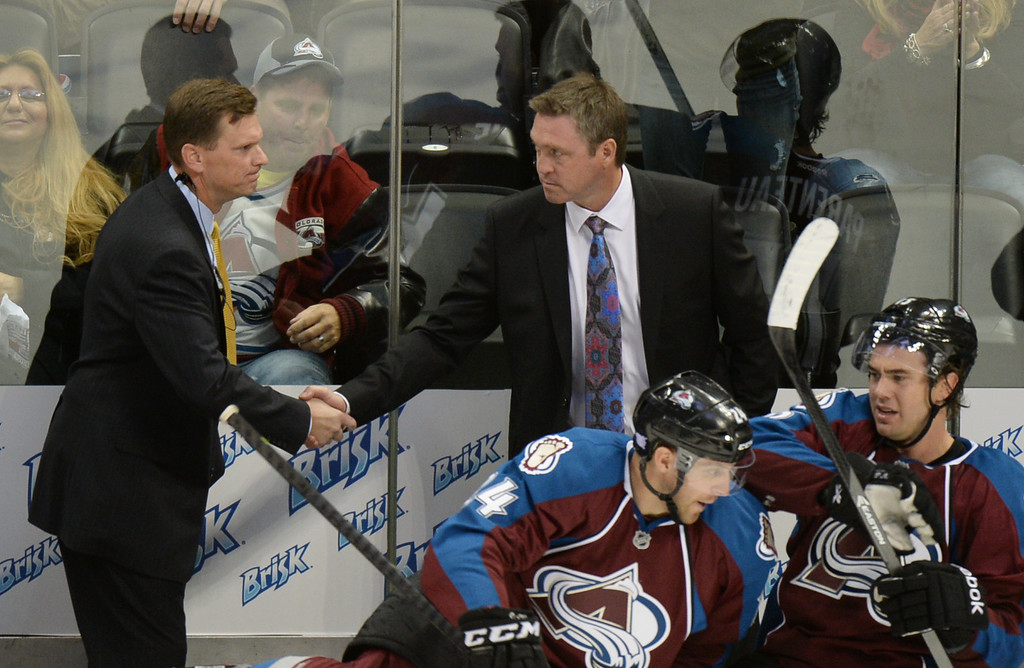 . DENVER, CO - OCTOBER 04 : Head coach Patrick Roy, top right, and assistant coach Tim Army of the Colorado Avalanche celebrate winning the game against the Nashville Predators at the Pepsi Center. Denver, Colorado. October 4, 2013. Colorado won 3-1. (Photo by Hyoung Chang/The Denver Post)