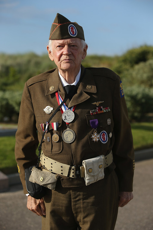 . D-Day veteran Frederick Carrier, 89, who served in the 1st Engineer Special Brigade of the U.S. Army, landed at Utah Beach and is from New York City, attends the U.S. D-Day Ceremony on June 5, 2014 at Utah Beach, France. Carrier says he designed the monument, which sits on top of a former German bunker, and built it with the help of 12 German prisoners of war in October, 1944, and that he hid three bottles of Calvados inside.(Photo by Sean Gallup/Getty Images)