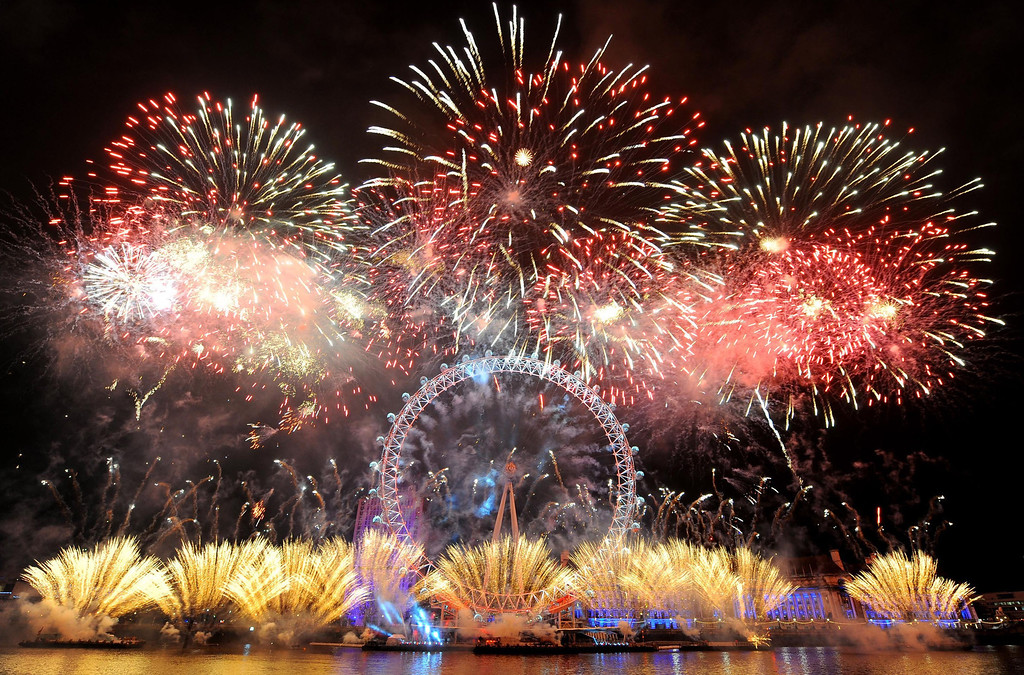 . Fireworks explode over the London Eye in central London, as part of the New Year celebrations Tuesday, Jan. 1, 2013. (AP Photo/PA, Dominic Lipinski)