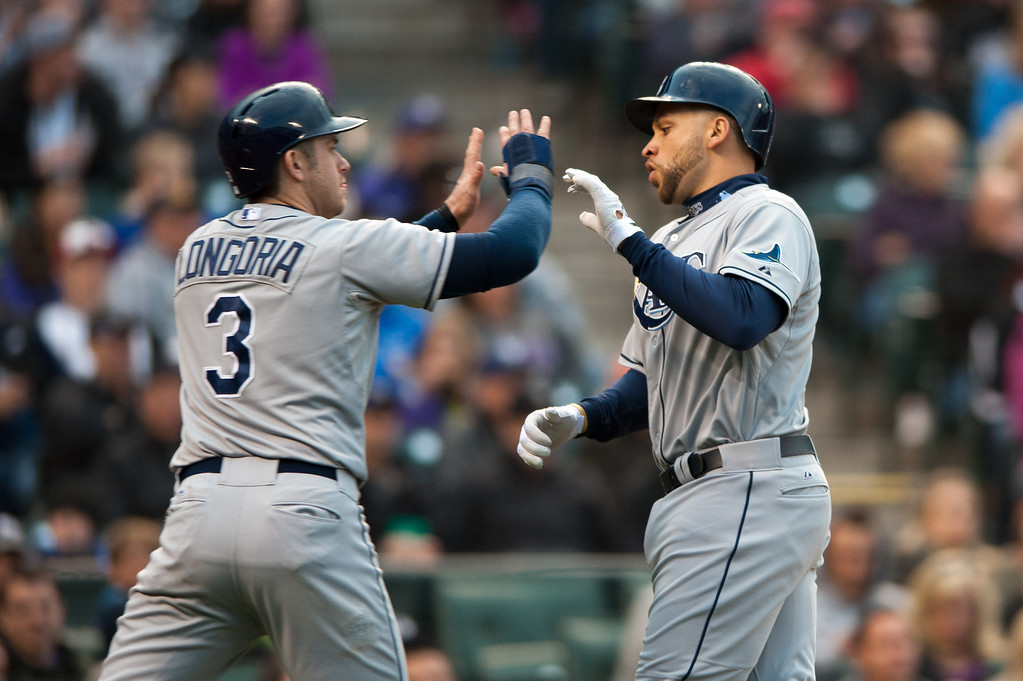 . DENVER, CO - MAY 4:  Evan Longoria #3 and James Loney #21 of the Tampa Bay Rays celebrate two runs scored in the third inning against the Colorado Rockies at Coors Field on May 4, 2013 in Denver, Colorado. The Rays led the Rockies 3-1 after 2 1/2 innings. (Photo by Dustin Bradford/Getty Images)