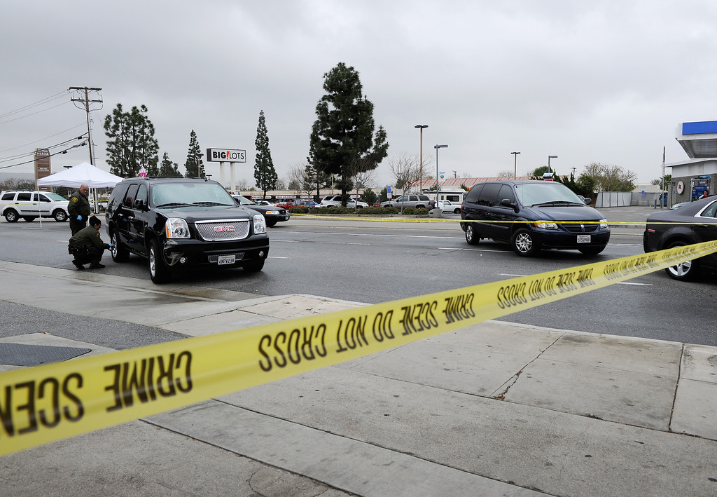 . Orange County Sheriff deputies investigate a crime scene on February 19, 2013 in Tustin, California.   (Photo by Kevork Djansezian/Getty Images)