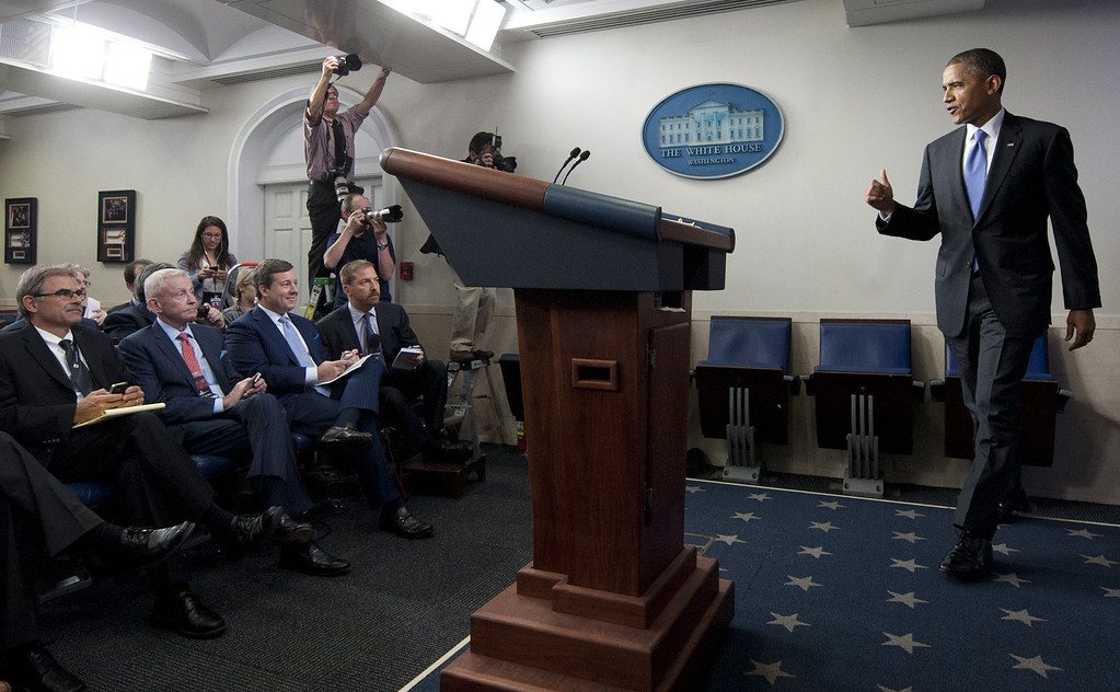 . US President Barack Obama arrives to speak about the government shutdown and debt ceiling standoff in the Brady Press Briefing Room of the White House in Washington, DC, October 16, 2013. SAUL LOEB/AFP/Getty Images