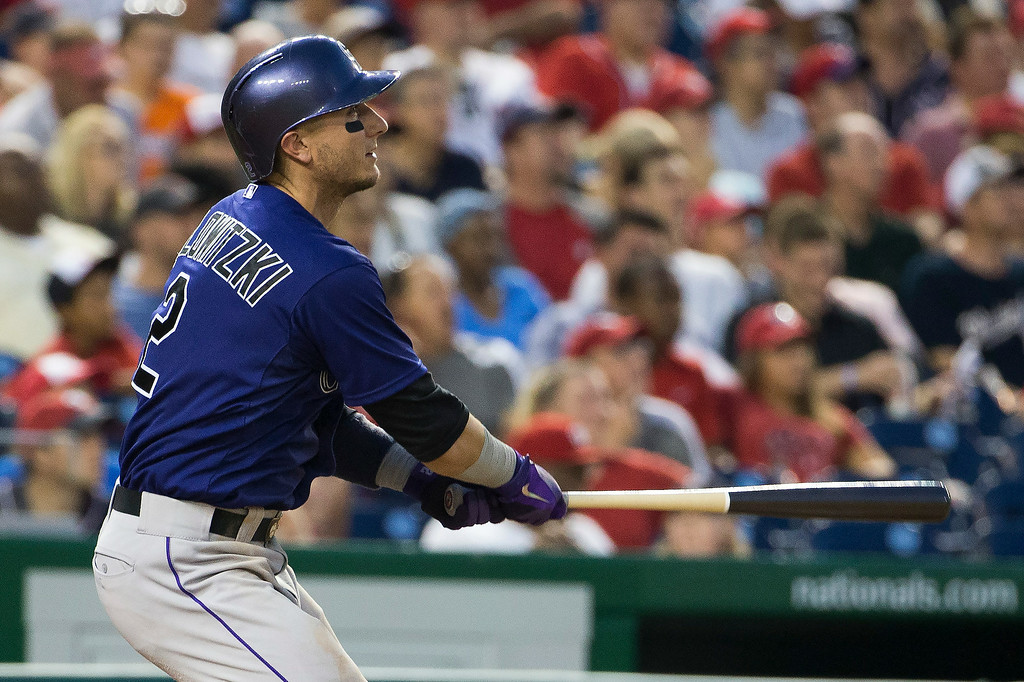 . Colorado Rockies Troy Tulowitzki hits an RBI double during the sixth inning of a baseball game against the Washington Nationals at Nationals Park, on Monday, June 30, 2014, in Washington. (AP Photo/Evan Vucci)