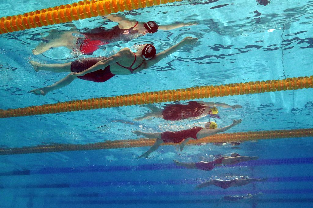 . Missy Franklin of the USA (L) and Emily Seebohm of Australia (C) compete in the Swimming Women\'s 100m Backstroke Final on day eleven of the 15th FINA World Championships at Palau Sant Jordi on July 30, 2013 in Barcelona, Spain.  (Photo by Clive Rose/Getty Images)