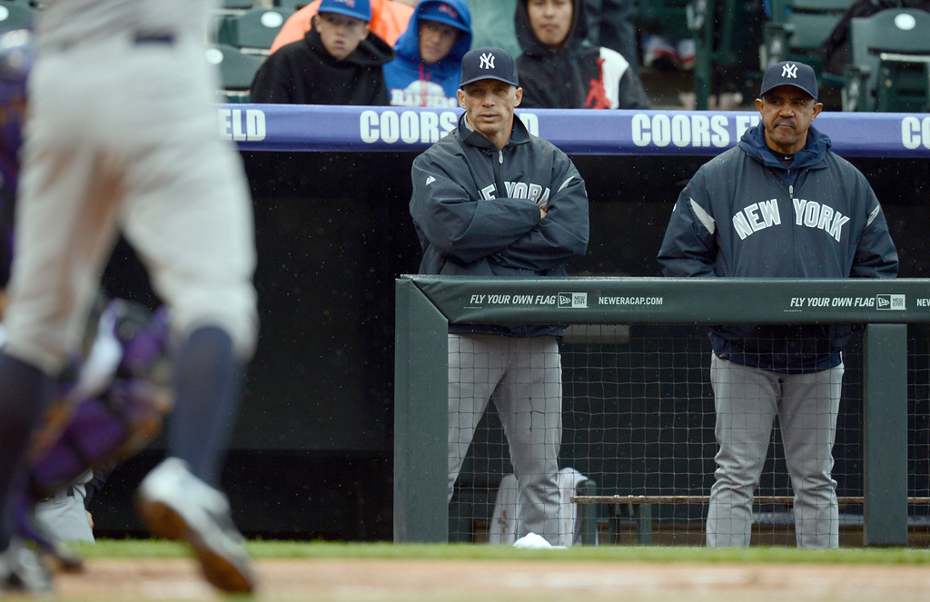 . Joe Girardi (28) of the New York Yankees (L) and Tony Pena (56) of the New York Yankees look on from the dugout during their game May 9, 2013 at Coors Field. (Photo By John Leyba/The Denver Post)