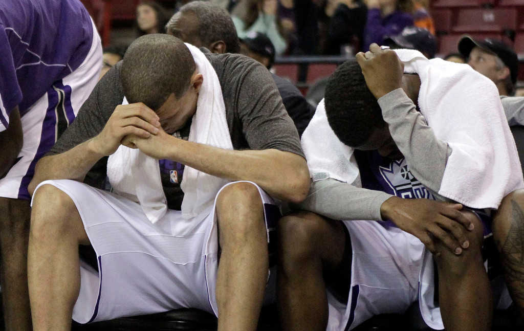 . Sacramento Kings\' Francisco Garcia, left,and Aaron Brooks sit with their heads down during the closing moments of the Kings 122-97 loss to the Denver Nuggets in an NBA basketball game in Sacramento, Calif., Sunday, Dec. 16, 2012.(AP Photo/Rich Pedroncelli)