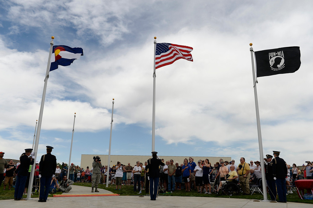 . Color guard raise the official colors of the Colorado Freedom Memorial during the dedication May 26, 2013 in Aurora.  (Photo By John Leyba/The Denver Post)