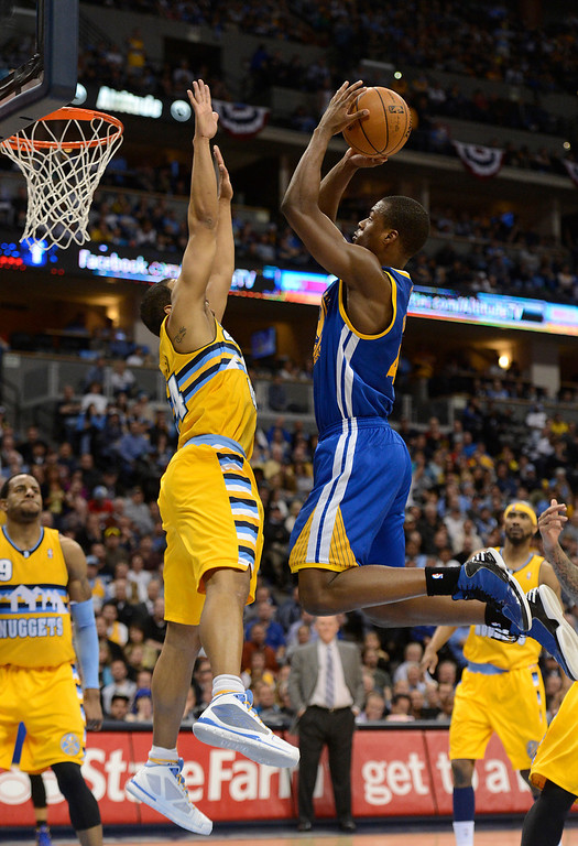 . DENVER, CO. - APRIL 23: Golden State Warriors small forward Harrison Barnes (40) puts up a shot over Denver Nuggets point guard Andre Miller (24) in the fourth quarter. The Denver Nuggets took on the Golden State Warriors in Game 2 of the Western Conference First Round Series at the Pepsi Center in Denver, Colo. on April 23, 2013. (Photo by John Leyba/The Denver Post)