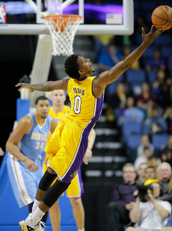 . Los Angeles Lakers\' Nick Young reaches for a loose ball in the first half of an NBA preseason basketball game against the Denver Nuggets on Tuesday, Oct. 8, 2013, in Ontario, Calif. (AP Photo/Jae C. Hong)
