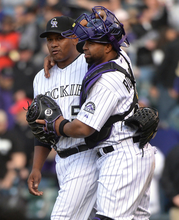 . DENVER, CO - APRIL 4:  Colorado closer Wilton Lopez and catcher Wilin Rosario celebrated the win Friday. The Colorado Rockies defeated the Arizona Diamondbacks 12-2 on opening day at Coors Field Friday afternoon, April 4, 2014 in Denver. (Photo by Karl Gehring/The Denver Post)