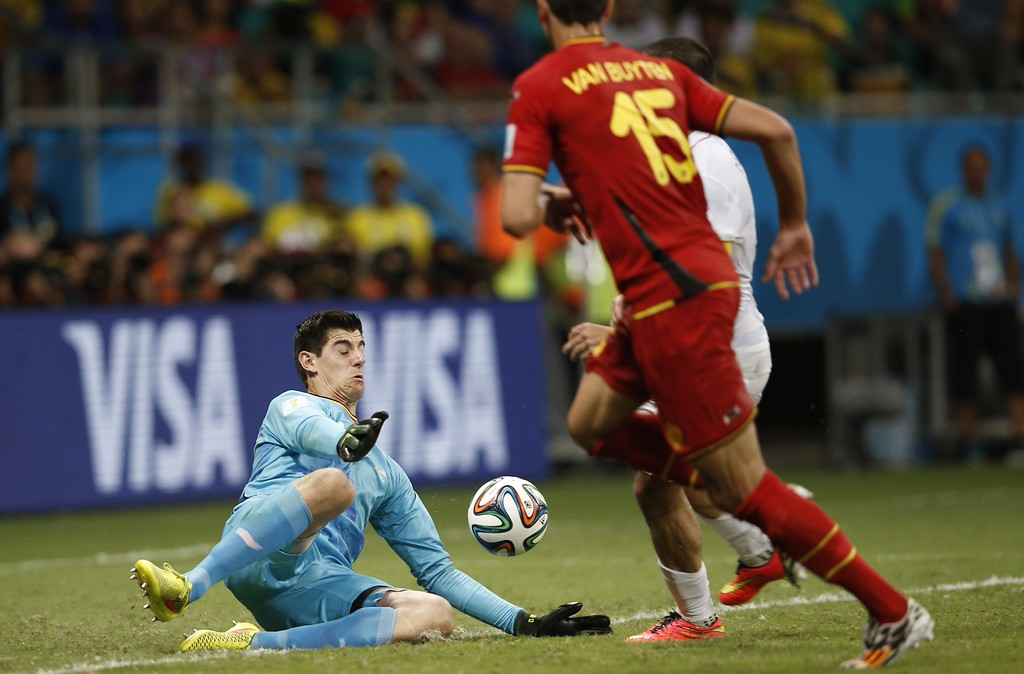 . Belgium\'s goalkeeper Thibaut Courtois (L) makes a save during extra-time in the Round of 16 football match between Belgium and USA at The Fonte Nova Arena in Salvador on July 1, 2014, during the 2014 FIFA World Cup. AFP PHOTO / ADRIAN DENNIS/AFP/Getty Images