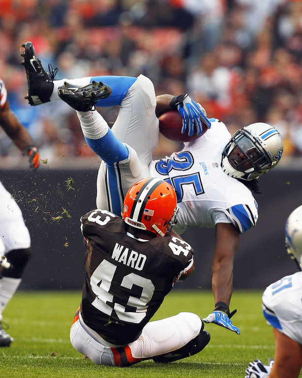 . Running back Joique Bell #35 of the Detroit Lions is tackled by defensive back T.J. Ward #43 of the Cleveland Browns at FirstEnergy Stadium on October 13, 2013 in Cleveland, Ohio.  (Photo by Matt Sullivan/Getty Images)