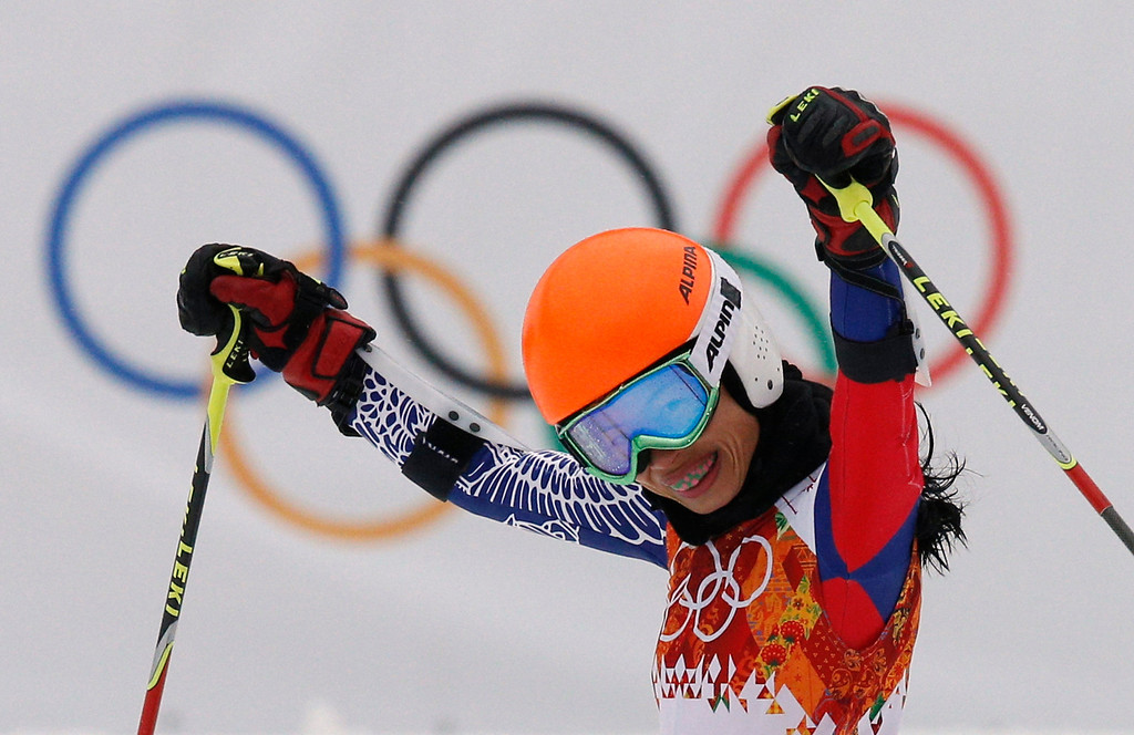 . Violinst Vanessa Mae starting under her father name as Vanessa Vanakorn for Thailand celebrates after completing the first run of the women\'s giant slalom at the Sochi 2014 Winter Olympics, Tuesday, Feb. 18, 2014, in Krasnaya Polyana, Russia.(AP Photo/Christophe Ena)