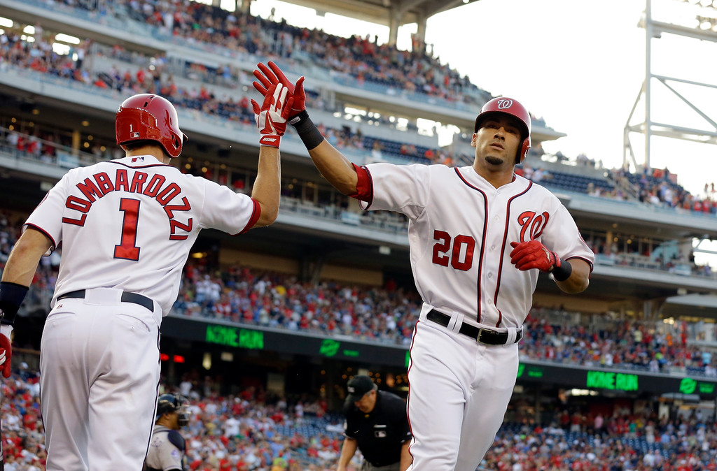 . Washington Nationals\' Ian Desmond (20) celebrates his solo home run with Stephen Lombardozzi (1) during the second inning of a baseball game against the Colorado Rockies at Nationals Park, Thursday, June 20, 2013, in Washington. (AP Photo/Alex Brandon)