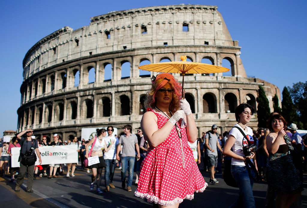 . A man dressed as a woman poses in front of the Colosseum during the annual gay pride parade in downtown Rome June 15, 2013. REUTERS/Max Rossi