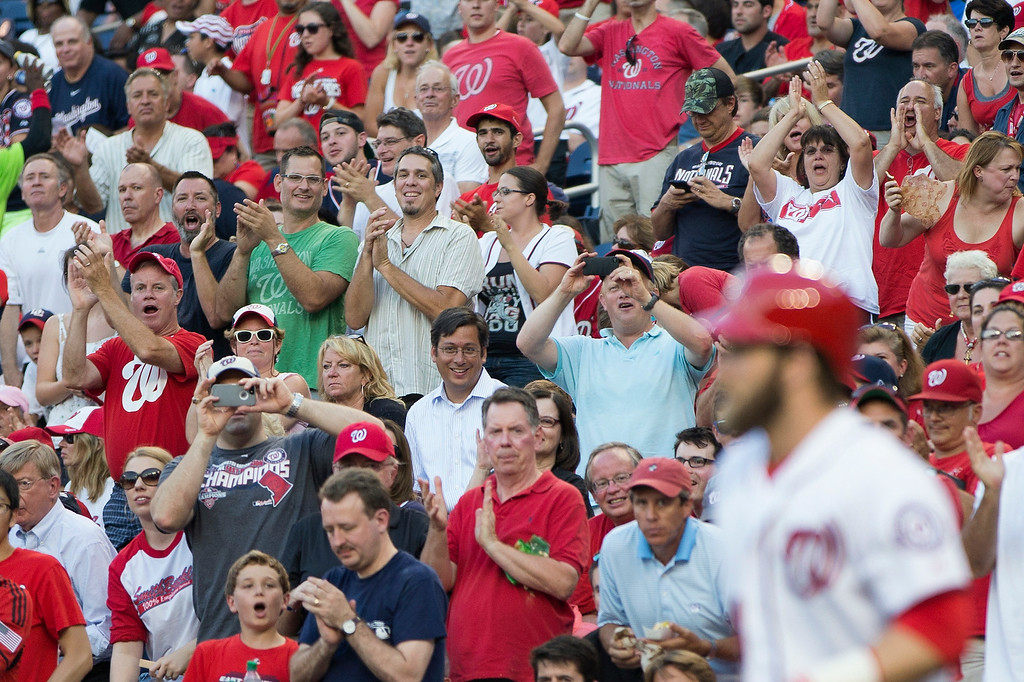 . Fans stand for Washington Nationals left fielder Bryce Harper as he walks out for his first at bat since returning from the disabled list during the second inning of a baseball game against the Colorado Rockies at Nationals Park, on Monday, June 30, 2014, in Washington. Harper, who missed 57 games because of a torn ligament in his left thumb, was batting sixth and playing left field as the Nationals opened a series against the Colorado Rockies on Bryce Harper bobblehead night. (AP Photo/ Evan Vucci)