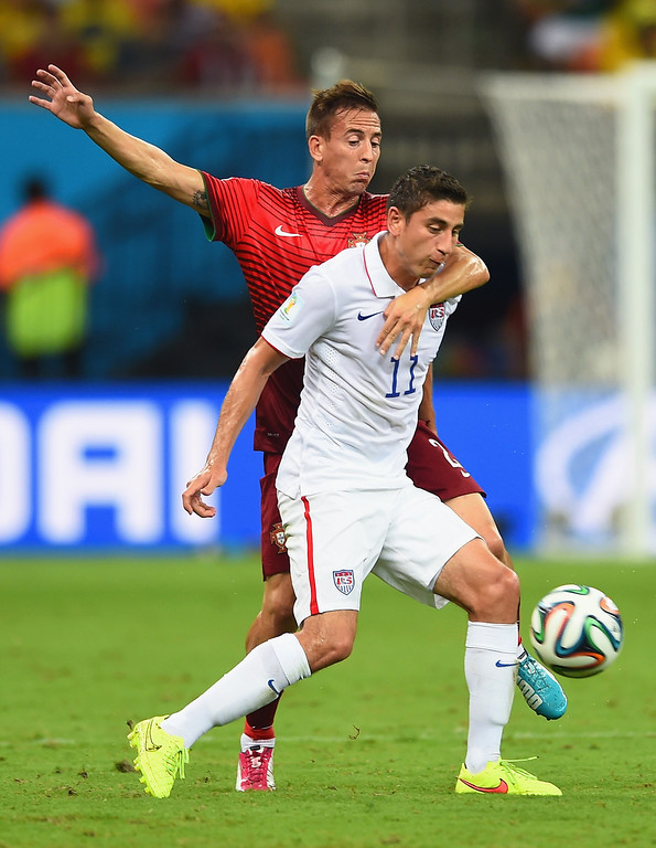 . Joao Pereira of Portugal challenges Alejandro Bedoya of the United States during the 2014 FIFA World Cup Brazil Group G match between the United States and Portugal at Arena Amazonia on June 22, 2014 in Manaus, Brazil.  (Photo by Christopher Lee/Getty Images)
