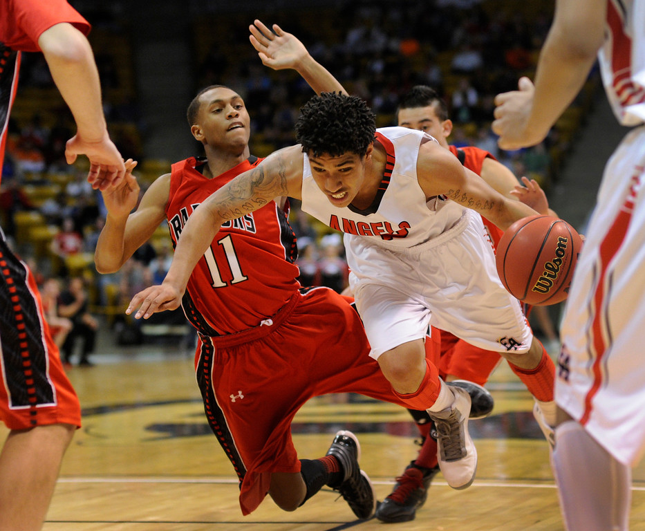 . BOULDER, CO. - MARCH 16: Raptor guard LaDerian King (11) took a swipe at East\'s Javon Griffin (25) in the second half. The Eaglecrest High School boy\'s basketball beat Denver East 63-44 in the 5A championship game Saturday, March 16, 2013 at the Coors Events Center in Boulder.  (Photo By Karl Gehring/The Denver Post)