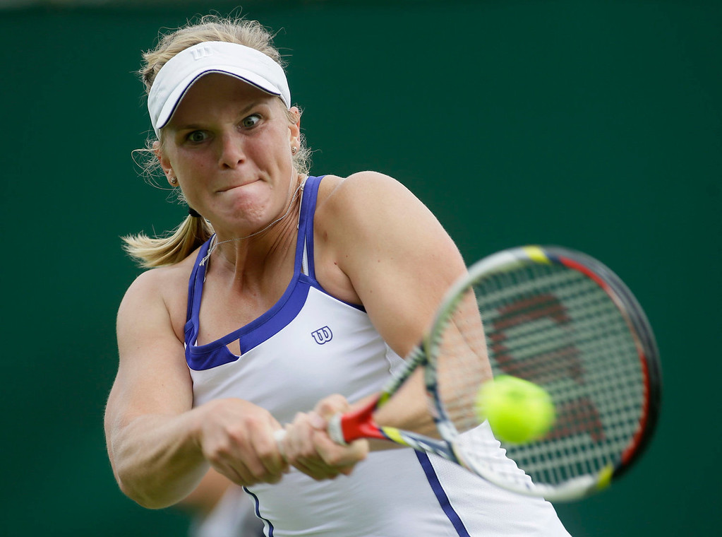 . Melanie Oudin of the United States returns to Michelle Larcher De Brito of Portugal during their Women\'s first round singles match at the All England Lawn Tennis Championships in Wimbledon, London, Monday, June 24, 2013.  (AP Photo/Alastair Grant)