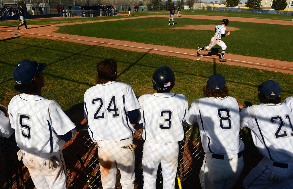 . LITTLETON, CO - APRIL 16,  2014:  Columbine Rebels Cody Wood, #17, makes a base hit during the fourth inning as his teammates cheer him on during their game against  the Ralston Valley Mustangs at Columbine High School in Littleton, Co on April 17, 2014. Columbine pitcher Blake Weiman had a great game and was taken out in the fifth inning when the Rebels were up 8 to 1 over the Mustangs. (Photo By Helen H. Richardson/ The Denver Post)