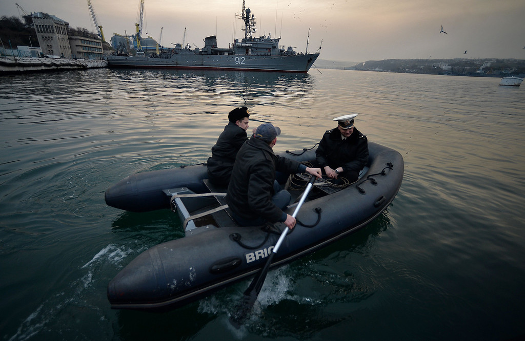 ". Officers from the Ukrainian navy ship Ternopil get on board of a boat in front of the Russian navy ship minesweeper ""Turbinist\"" anchored at the harbor of Sevastopol on March 11, 2014.  Lawmakers on the flashpoint Crimean peninsula voted on March 11 for independence from Ukraine ahead of a referendum on joining Russia while Washington rebuffed talks with Moscow in one of their fiercest clashes since the Cold War. The strategic region\'s self-declared rulers are recruiting volunteers to fight Ukrainian soldiers while Russia\'s parliament on March 11 prepared legislation that would simplify the Kremlin\'s annexation of Crimea after the weekend\'s vote.  FILIPPO MONTEFORTE/AFP/Getty Images"