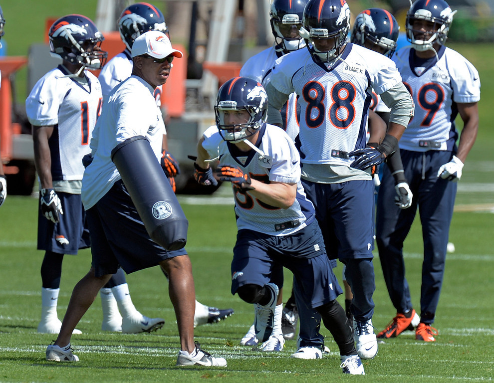 . Wes Welker (83) of the Denver Broncos runs through drills during the teams OTAs May 20, 2013 at Dove Valley. All offseason training activities (OTAs) are voluntary until the mandatory minicamp June 11-13. (Photo By John Leyba/The Denver Post)