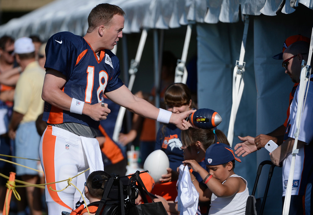 . ENGLEWOOD, CO - JULY 27: Denver Broncos QB, Peyton Manning took time to sign a few autographs before the start of training camp at Dove Valley Saturday July 26, 2013.  (Photo By Andy Cross/The Denver Post)