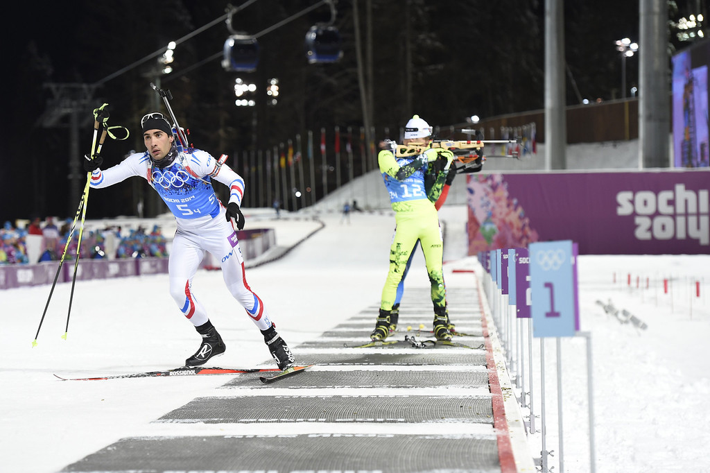 . France\'s Martin Fourcade  leaves the range as he competes in the Biathlon mixed 2x6 km + 2x7,5 km Relay at the Laura Cross-Country Ski and Biathlon Center during the Sochi Winter Olympics on February 19, 2014 in Rosa Khutor near Sochi. AFP PHOTO / ODD ANDERSEN/AFP/Getty Images