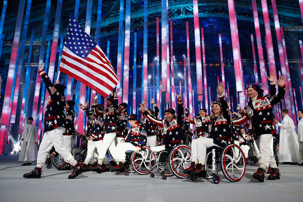 . Jonathan Lujan of United States carries the flag during the Opening Ceremony of the Sochi 2014 Paralympic Winter Games at Fisht Olympic Stadium on March 7, 2014 in Sochi, Russia.  (Photo by Tom Pennington/Getty Images)