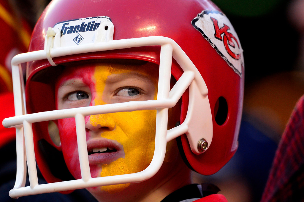 . KANSAS CITY, MO - DECEMBER 01: A young Kansas City Chiefs fan watches the action against the Denver Broncos during the first half of action at Arrowhead Stadium. The Denver Broncos visit the Kansas City Chiefs in an AFC West showdown. (Photo by AAron Ontiveroz/The Denver Post)