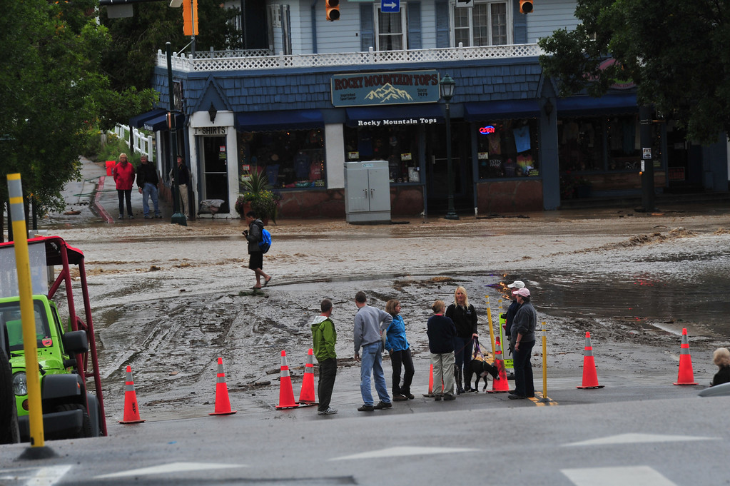 . Curious residents check out rain and mud at Elkhorn and Moraine avenues on Friday, September 13, 2013.  Walt Hester/Estes Park Trail-Gazette