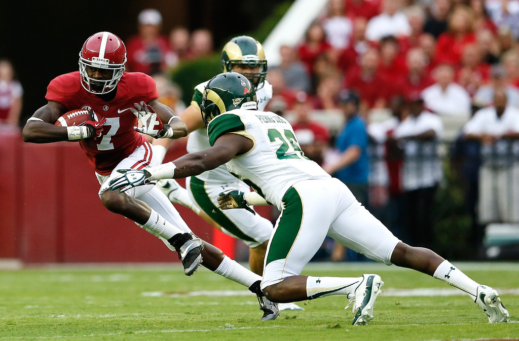 . TUSCALOOSA, AL - SEPTEMBER 21:  Kenny Bell #7 of the Alabama Crimson Tide breaks a tackle by Kevin Pierre-Louis #26 of the Colorado State Rams at Bryant-Denny Stadium on September 21, 2013 in Tuscaloosa, Alabama.  (Photo by Kevin C. Cox/Getty Images)
