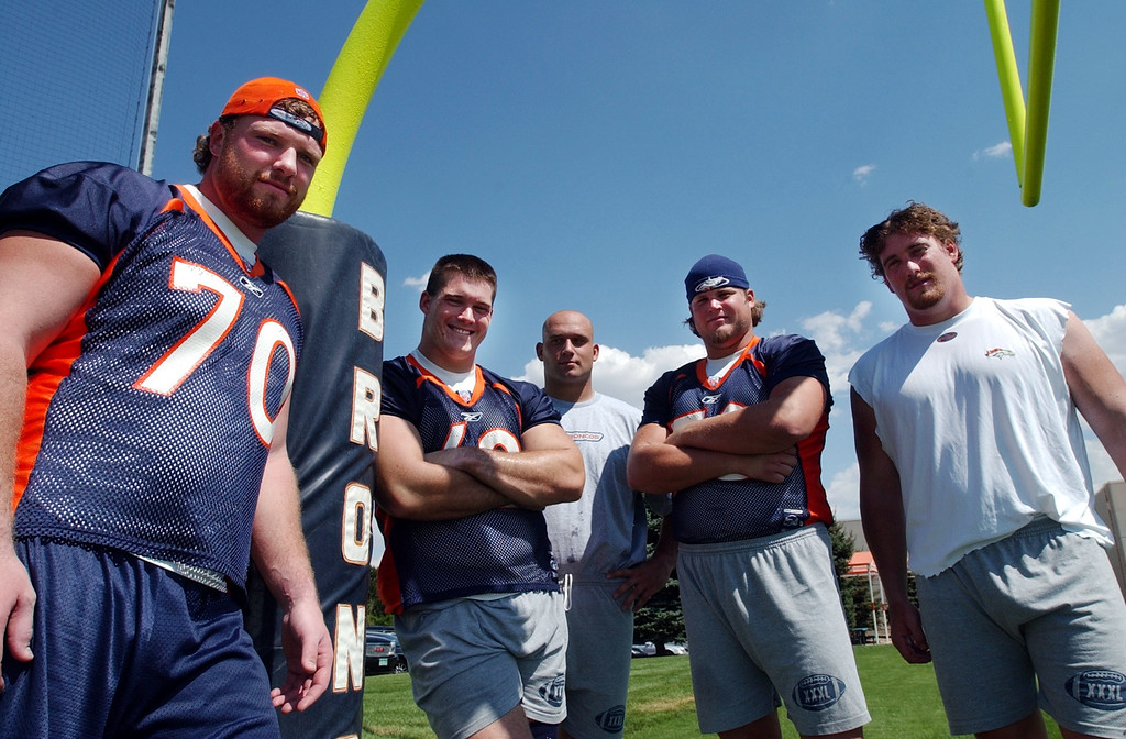 . From left, Denver Broncos Offensive Lineman Trey Teague, Dan Neil, Lennie Friedman, Matt Lepsis and Tom Nalen at the  Denver Broncos\' Dove Valley facility on Monday. HYOUNG CHANG, The Denver post