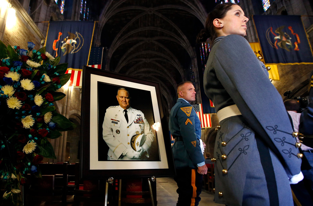 . A U.S. Military Academy Cadet and a New Jersey State Police officer stand next to a portrait of the late U.S. Four Star General H. Norman Schwarzkopf at the entrance to the Cadet Chapel at the United States Military Academy at West Point, for Schwarzkopf\'s funeral service February 28, 2013.  REUTERS/Mike Segar