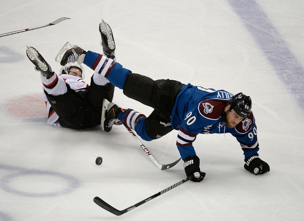 . Colorado Avalanche center Ryan O\'Reilly (90) gets tripped up by New Jersey Devils defenseman Eric Gelinas (22) during the second period January 16, 2014 at Pepsi Center. Gelinas was called for a penalty. (Photo by John Leyba/The Denver Post)