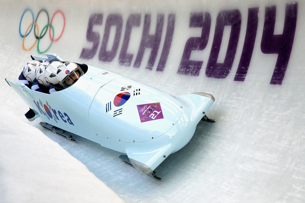 . Pilot Yunjong Won, Youngjin Suk, Junglin Jun and Youngwoo Seo of Korea team 1 make a run during the Men\'s Four-Man Bobsleigh on Day 16 of the Sochi 2014 Winter Olympics at Sliding Center Sanki on February 23, 2014 in Sochi, Russia.  (Photo by Adam Pretty/Getty Images)