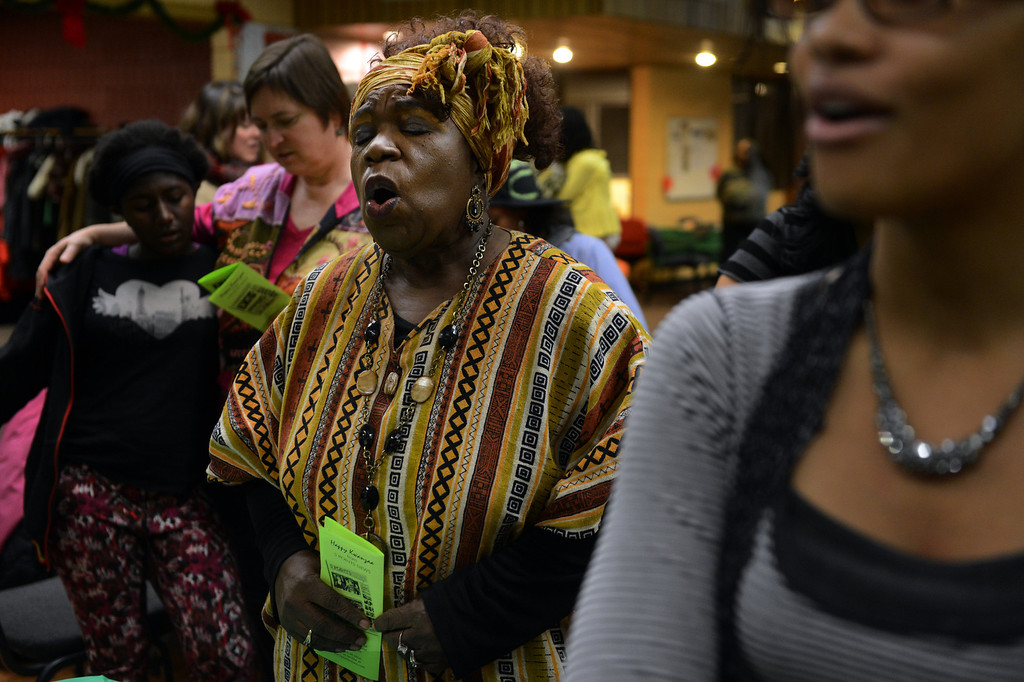 . Claudette Sweet joins in song during a Kwanzaa Celebration at the Zion Senior Center in Denver, CO, Saturday December, 29, 2012. The event highlighted the 150th anniversary of the Emancipation Proclamation with a theatrical performance depicting an enslaved family on Watch Night or Freedom\'s Eve, December 31, 1862. During the performance the family read the proclamation in anticipation of their coming freedom on New Years day, 1863. Craig F. Walker, The Denver Post