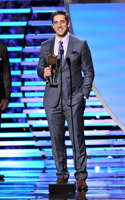 . Aaron Rodgers of the Green Bay Packers accepts his award for the Never Say Never Moment of the Year award at the third annual NFL Honors at Radio City Music Hall on Saturday, Feb. 1, 2014, in New York. (Photo by Evan Agostini/Invision for NFL/AP Images)