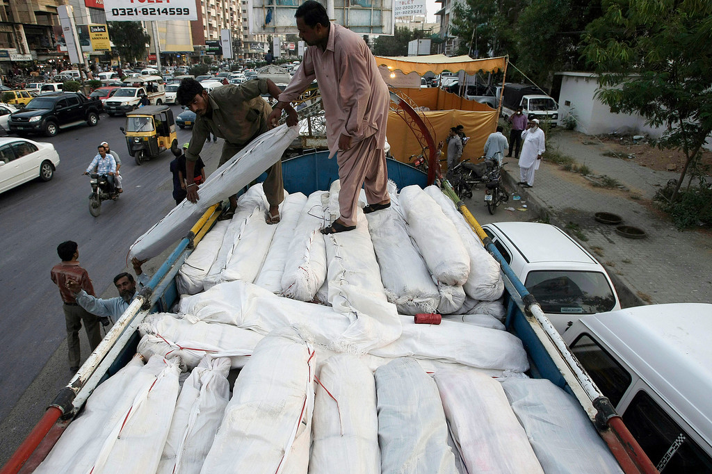 . Pakistani volunteers load tents and other relief supplies into a truck to send it for earthquake-affected areas of the Baluchistan province, in Karachi, Pakistan, Saturday, Sept. 28, 2013. A major earthquake rocked Pakistan\'s southwest Saturday, sending people running into the street in panic just days after another quake in the same region killed hundreds of people, officials said. (AP Photo/Fareed Khan)