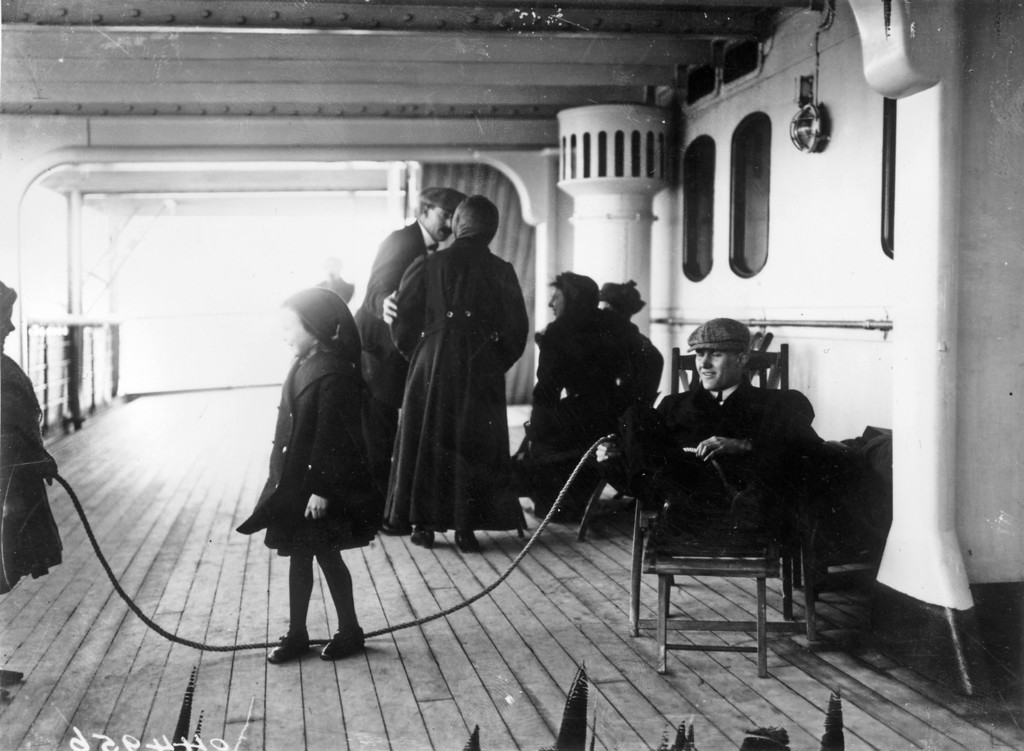 . Children playing with a skipping rope on the 2nd saloon deck of the Cunard liner RMS Lusitania. Circa 1912.  (Photo by Topical Press Agency/Getty Images)