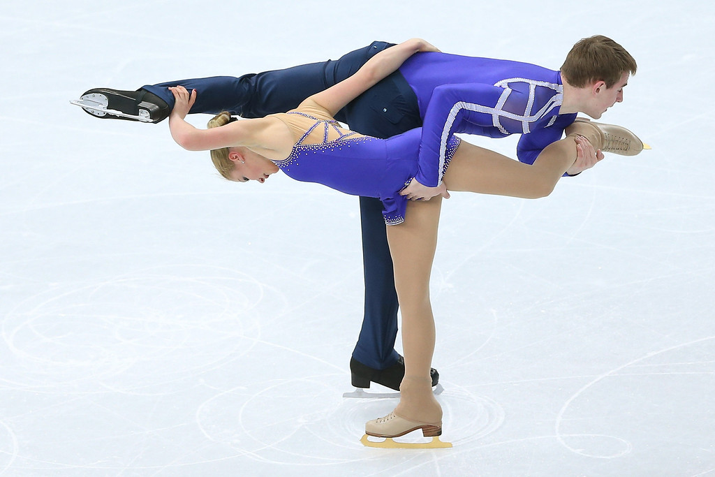 Description of . Julia Lavrentieva and Yuri Rudyk of Ukraine compete during the Figure Skating Pairs Short Program on day four of the Sochi 2014 Winter Olympics at Iceberg Skating Palace on February 11, 2014 in Sochi, Russia.  (Photo by Matthew Stockman/Getty Images)