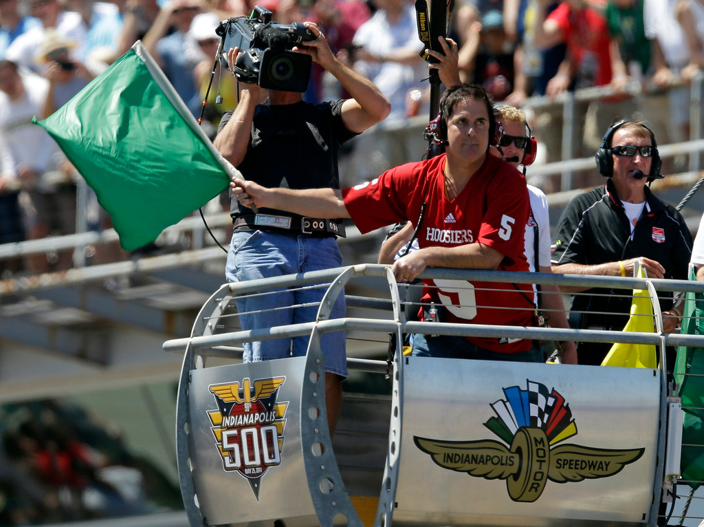 . Dallas Mavericks owner Mark Cuban waves the green flag to start the 98th running of the Indianapolis 500 IndyCar auto race at the Indianapolis Motor Speedway in Indianapolis, Sunday, May 25, 2014. (AP Photo/Michael Conroy)