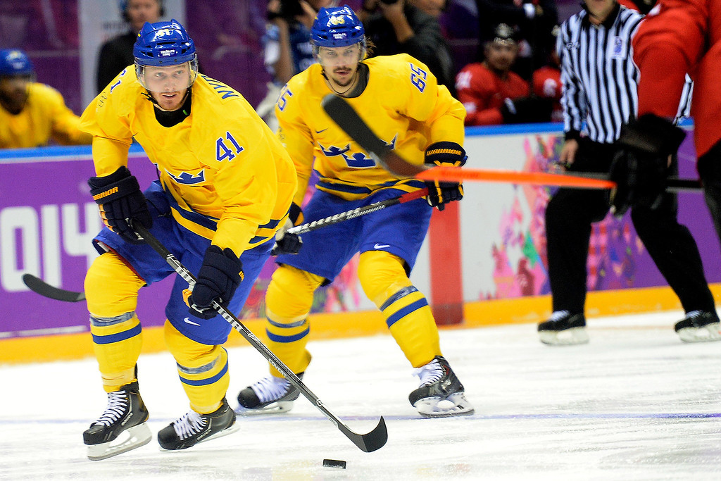 . Sweden\'s Gustav Nyquist brings the puck up the ice against Switzerland during the action at Bolshoy Arena. Sochi 2014 Winter Olympics on Friday, February 14, 2014. (Photo by AAron Ontiveroz/The Denver Post)