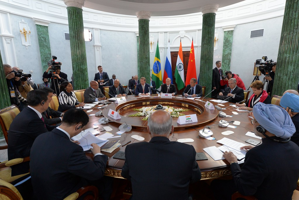 . In this handout image provided by Host Photo Agency, leaders sit at a table for the BRICS summit during the G20 summit on September 5, 2013 in St. Petersburg, Russia.   (Photo by Mikhail Kireev/Host Photo Agency via Getty Images)