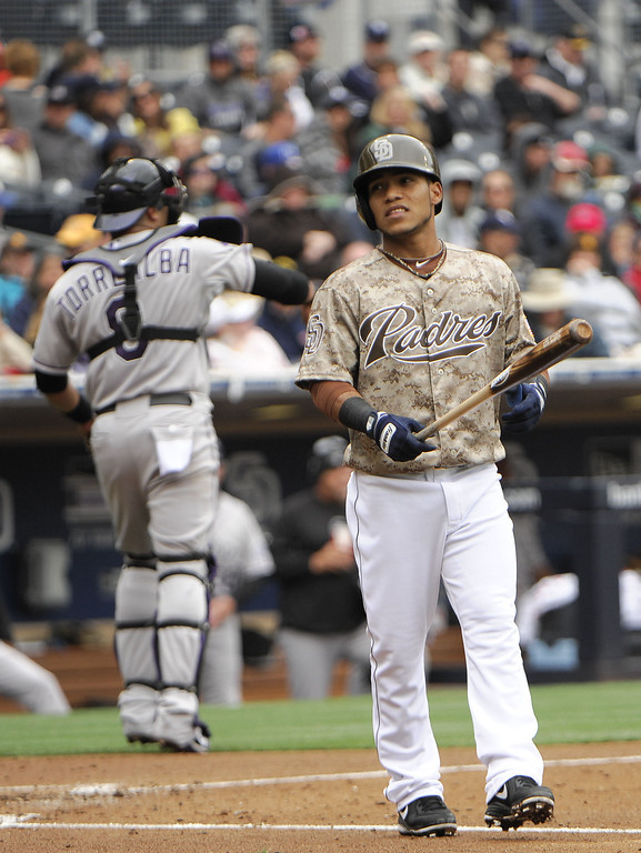 . Alexi Amarista #5 of the San Diego Padres reacts after striking out during the second inning of a baseball game against the Colorado Rockies at Petco Park on April 14, 2013 in San Diego, California.  (Photo by Denis Poroy/Getty Images)