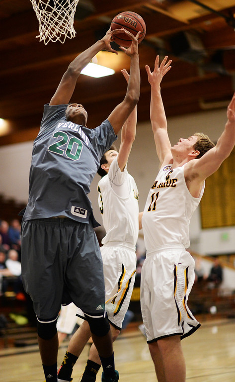 . CENTENNIAL, CO. JANUARY 18: From left, De\'Ron Davis of Overland High School (20) is fighting for the rebound against Nick Farmen (3) and Ethan Brunhofer (11) of Arapahoe High School in the 1st half of the game at Arapahoe High School. Centennial Colorado. January 18. 2014. Arapahoe won 62-54.  (Photo by Hyoung Chang/The Denver Post)