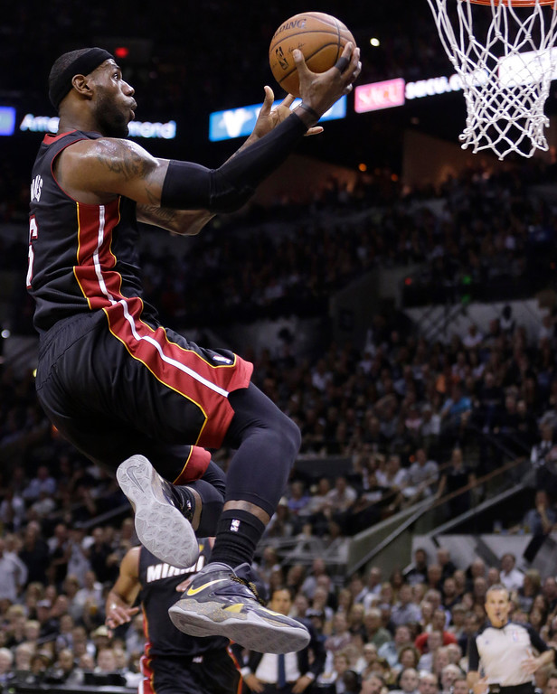 . Miami Heat forward LeBron James shoots against the San Antonio Spurs during the first half in Game 5 of the NBA basketball finals on Sunday, June 15, 2014, in San Antonio. (AP Photo/David J. Phillip)