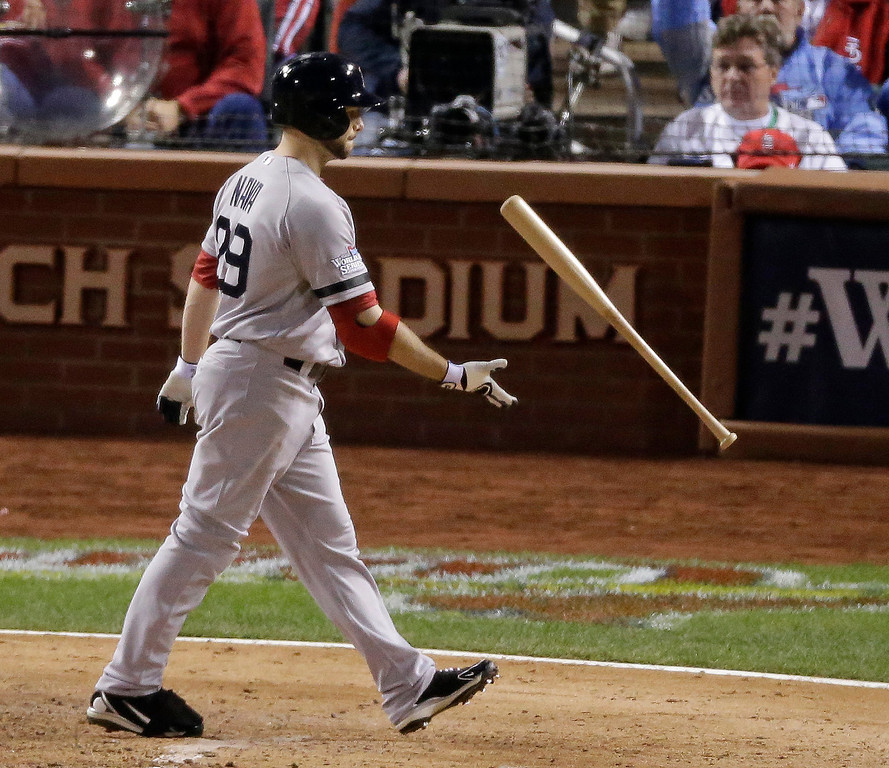. Boston Red Sox\'s Daniel Nava tosses his bat after striking out during the seventh inning of Game 5 of baseball\'s World Series against the St. Louis Cardinals Monday, Oct. 28, 2013, in St. Louis. (AP Photo/Charlie Riedel)