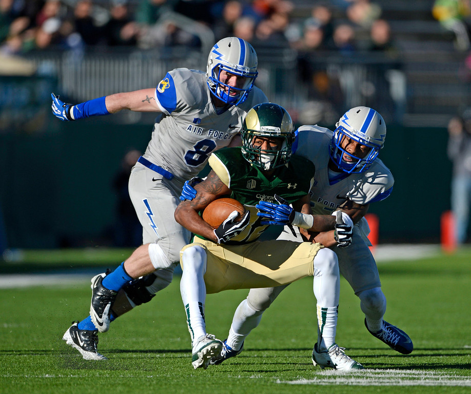 . Colorado State WR, Rashard Higgins, center, gets wrapped up by Air Force defenders, Jared Jones, left, and Steffon Batts, in the third quarter at Hughes Stadium Saturday afternoon, November 30, 2013. The Rams went on to win 58-13. (Photo By Andy Cross/The Denver Post)